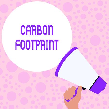 Writing note showing Carbon Footprint. Business concept for amount of dioxide released atmosphere result of activities Hand Holding Loudhailer Speech Text Balloon Announcement New Stock Photo