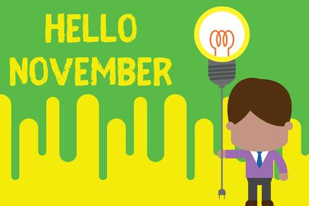 Handwriting text Hello November. Conceptual photo Welcome the eleventh month of the year Month before December Standing man tie holding plug socket light bulb to connect idea. Startup Banque d'images - 124906247
