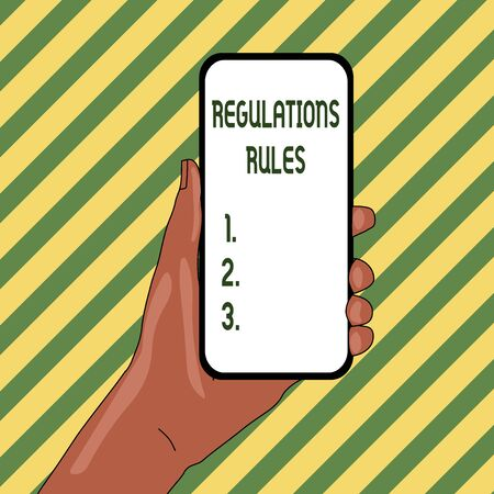 Handwriting text Regulations Rules. Conceptual photo Standard Statement Procedure govern to control a conduct Closeup of Smartphone Device Held in Hand with Empty Screen and Text Space Reklamní fotografie