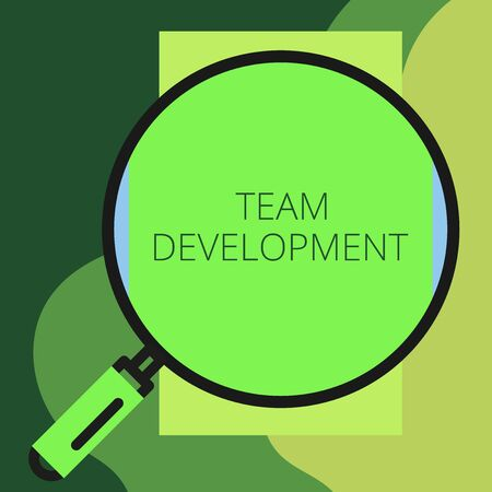Writing note showing Team Development. Business concept for learn why and how small groups change over time with graphs Round magnifying glass with iron handle frame to look bigger
