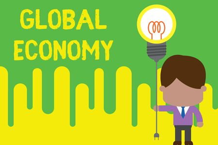Handwriting text Global Economy. Conceptual photo System of industry and trade around the world Capitalism Standing man tie holding plug socket light bulb to connect idea. Startup