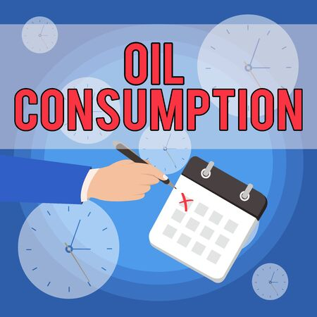 Text sign showing Oil Consumption. Business photo showcasing This entry is the total oil consumed in barrels per day Male Hand Formal Suit Crosses Off One Day Calendar Red Ink Ballpoint Pen