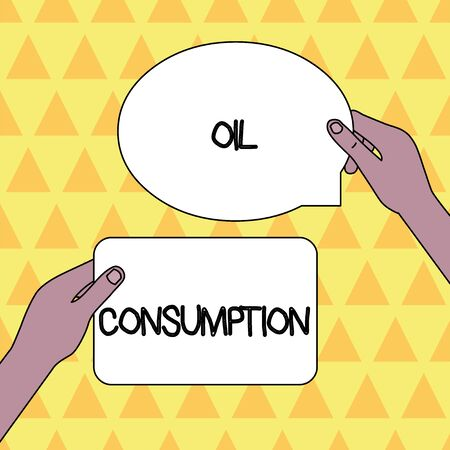 Handwriting text Oil Consumption. Conceptual photo This entry is the total oil consumed in barrels per day Two Blank Figured Tablets Signs Held in Hands One Above Other Text Space