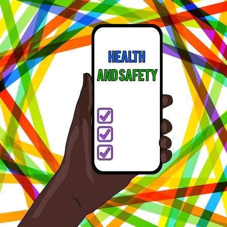 Handwriting text writing Health And Safety. Conceptual photo procedures intended to prevent accident in workplace Closeup of Smartphone Device Held in Hand with Empty Screen and Text Space