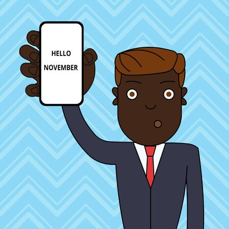 Handwriting text Hello November. Conceptual photo Welcome the eleventh month of the year Month before December Man Holding Vertically Smartphone Device with Blank Screen for Attention Imagens