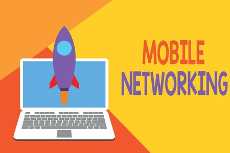 Text sign showing Mobile Networking. Business photo showcasing Communication network where the last link is wireless Launching rocket up laptop . Startup project. Developing goal objectives Banco de Imagens - 124979842