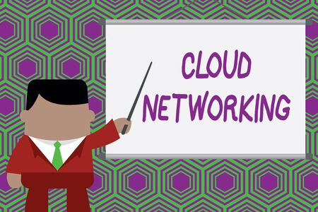 Conceptual hand writing showing Cloud Networking. Concept meaning is term describing access of networking resources Businessman standing in front projector pointing project idea 写真素材