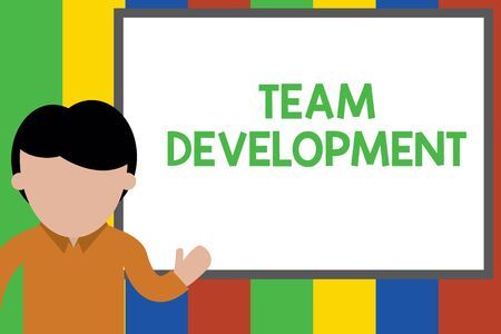 Writing note showing Team Development. Business concept for learn why and how small groups change over time with graphs Young man standing in front whiteboard pointing to project. photo Art Stock Photo