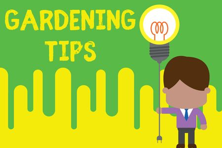 Handwriting text Gardening Tips. Conceptual photo Proper Practices in growing crops Botanical Approach Standing man tie holding plug socket light bulb to connect idea. Startup