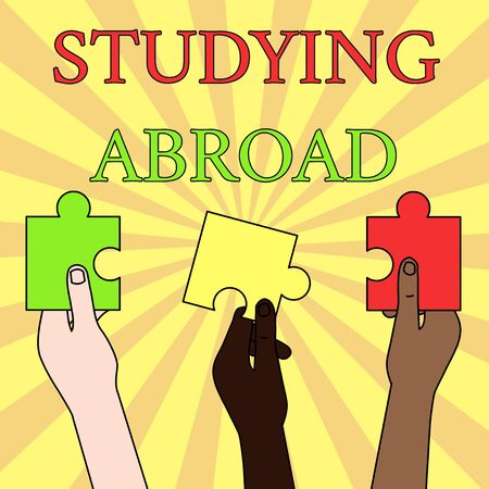 Writing note showing Studying Abroad. Business concept for learn outside of home in foreign country Travelling Three Colored Empty Jigsaw Puzzle Pieces Held in Different People Hands