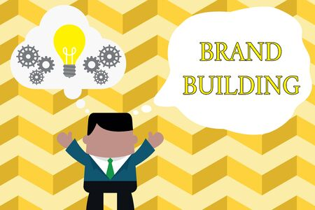 Handwriting text writing Brand Building. Conceptual photo Generating awareness Establishing and promoting company Standing man suit hands up imaginary bubble light bulb gears working together 版權商用圖片