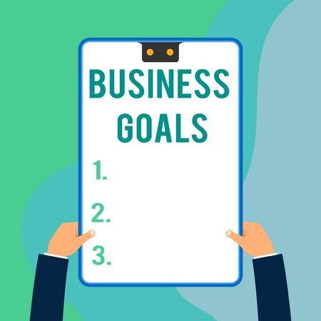 Conceptual hand writing showing Business Goals. Concept meaning Expectation to accomplish over a specific period of time Two executive male hands electronic device geometrical background