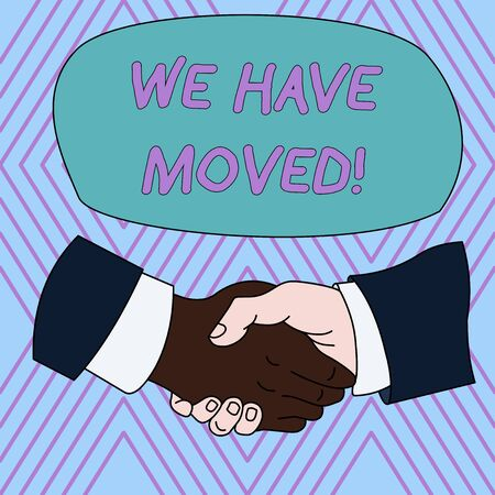 Text sign showing We Have Moved. Business photo text To go from one residence or location to another Relocate Hand Shake Multiracial Male Business Partners Colleagues Formal Shirt Suit