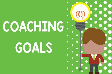 Text sign showing Coaching Goals. Business photo text Empowers individuals Encourages them to take responsibility Standing man tie holding plug socket light bulb to connect idea. Startup Banco de Imagens - 124993427