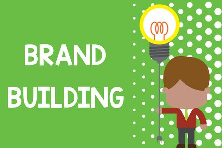 Text sign showing Brand Building. Business photo text Generating awareness Establishing and promoting company Standing man tie holding plug socket light bulb to connect idea. Startup