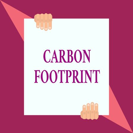 Conceptual hand writing showing Carbon Footprint. Concept meaning amount of dioxide released atmosphere result of activities Two hands hold one big white paper placed on top and bottom