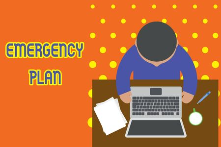 Handwriting text writing Emergency Plan. Conceptual photo Procedures for response to major emergencies Be prepared Upper view young man sitting working table laptop documents coffee cup pen 스톡 콘텐츠 - 124997498