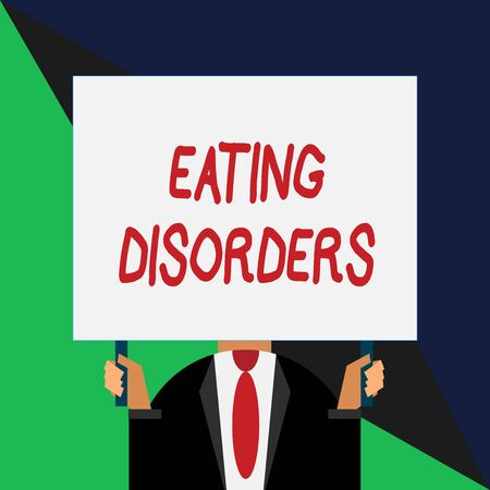 Conceptual hand writing showing Eating Disorders. Concept meaning any of a range of psychological abnormal food habits Just man chest dark suit tie no face holding blank rectangle