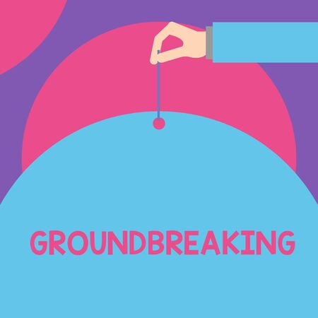 Handwriting text Groundbreaking. Conceptual photo Very new and a big change from other things of its type Male hand arm needle punching big half blank balloon geometrical background Stock Photo