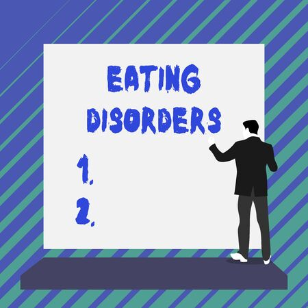 Writing note showing Eating Disorders. Business concept for any of a range of psychological abnormal food habits Short hair immature young man stand in front of rectangle big board Stok Fotoğraf