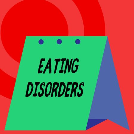 Word writing text Eating Disorders. Business photo showcasing any of a range of psychological abnormal food habits Open big standing calendar Desk monthly planner Geometrical background