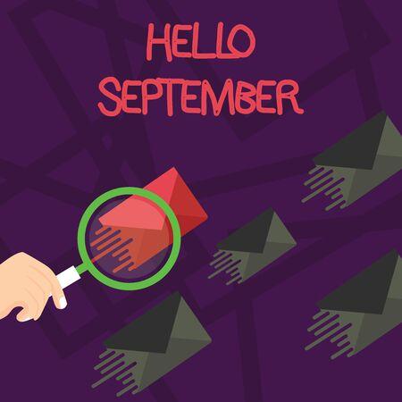 Schreiben Hinweis mit Hallo September. Geschäftskonzept für Eifrig, das den Monat September herzlich willkommen heißt Lupe auf Farbumschlag und anderen hat den gleichen Farbton Standard-Bild