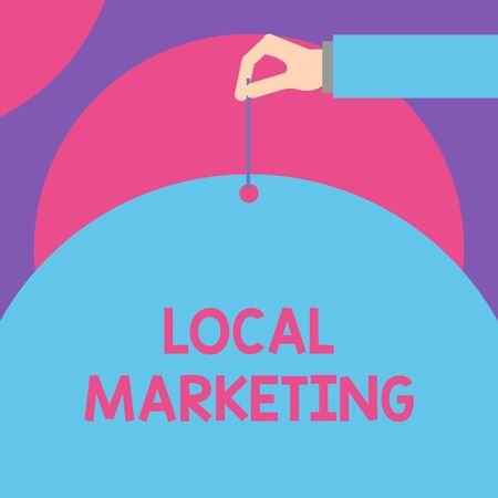 Handwriting text Local Marketing. Conceptual photo A local business where a product buy and sell in area base Male hand arm needle punching big half blank balloon geometrical background