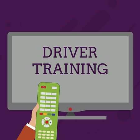 Word writing text Driver Training. Business photo showcasing prepares a new driver to obtain a driver s is license Hand Holding Computer Remote Control infront of Blank Wide Color PC Screen Imagens
