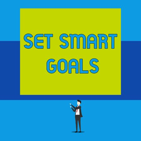 Word writing text Set Smart Goals. Business photo showcasing giving criteria to guide in the setting of objectives Isolated view young man standing pointing upwards two hands big rectangle Imagens