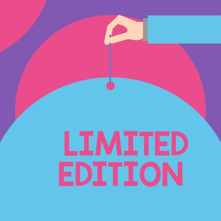 Handwriting text Limited Edition. Conceptual photo Work of something which is only produced in small numbers Male hand arm needle punching big half blank balloon geometrical background