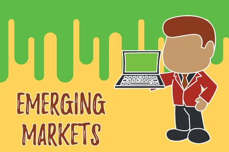 Conceptual hand writing showing Emerging Markets. Concept meaning country that has some characteristics of developed stores Standing businessman holding open laptop right hand side