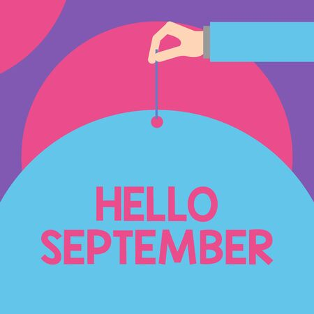 Handwriting text Hello September. Conceptual photo Eagerly wanting a warm welcome to the month of September Male hand arm needle punching big half blank balloon geometrical background