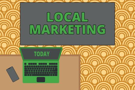 Writing note showing Local Marketing. Business concept for A local business where a product buy and sell in area base Office working place laptop lying wooden desk smartphone