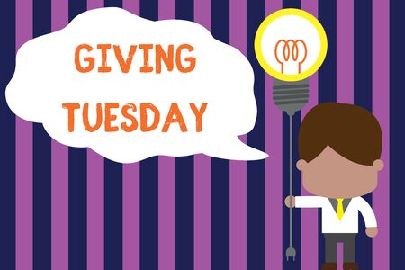 Text sign showing Giving Tuesday. Business photo showcasing international day of charitable giving Hashtag activism Standing man tie holding plug socket light bulb to connect idea. Startup