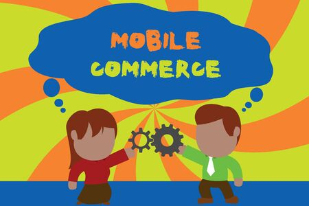 Text sign showing Mobile Commerce. Business photo showcasing Using mobile phone to conduct commercial transactions online Standing young couple sharing gear. Man tie woman skirt commerce relation