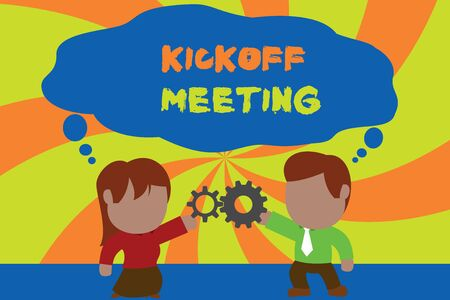 Text sign showing Kickoff Meeting. Business photo showcasing Special discussion on the legalities involved in the project Standing young couple sharing gear. Man tie woman skirt commerce relation