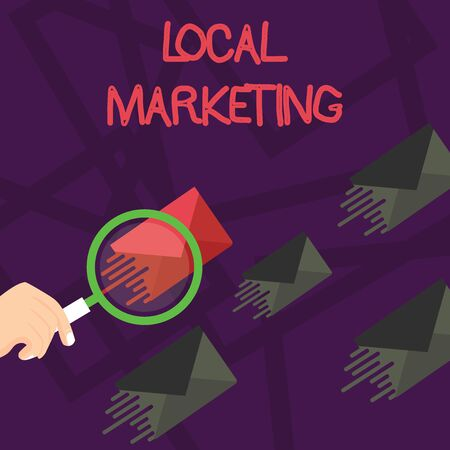 Writing note showing Local Marketing. Business concept for A local business where a product buy and sell in area base Magnifying Glass on Color Envelope and others has Same Shade Фото со стока