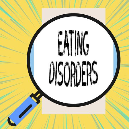 Writing note showing Eating Disorders. Business concept for any of a range of psychological abnormal food habits Big magnifier glass looking vertical rectangle. Geometrical background Stok Fotoğraf