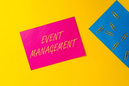 Conceptual hand writing showing Event Management. Concept meaning creation and development of large scale actions festivals Blank paper sheets message reminder clips binders color background Zdjęcie Seryjne - 125249207