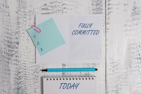 Word writing text Fully Committed. Business photo showcasing Extremely agreed to do something in life definitely Open squared spiral notepad clip note highlighter lying old wooden background