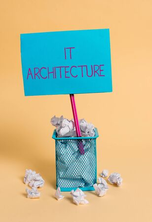Word writing text It Architecture. Business photo showcasing Architecture is applied to the process of overall structure crumpled paper trash and stationary with note paper placed in the trash can