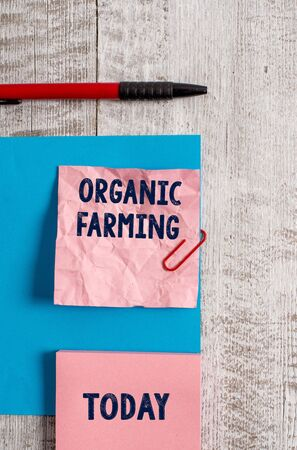 Word writing text Organic Farming. Business photo showcasing an integrated farming system that strives for sustainability Wrinkle paper and cardboard plus stationary placed above wooden background Banco de Imagens