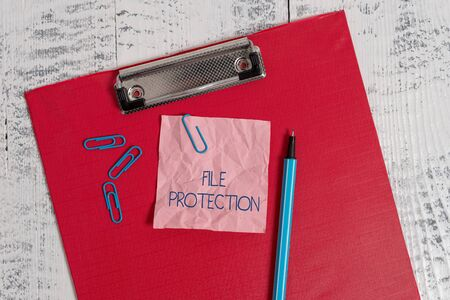 Writing note showing File Protection. Business concept for Preventing accidental erasing of data using storage medium Colored clipboard crushed sticky note clip marker old wooden background