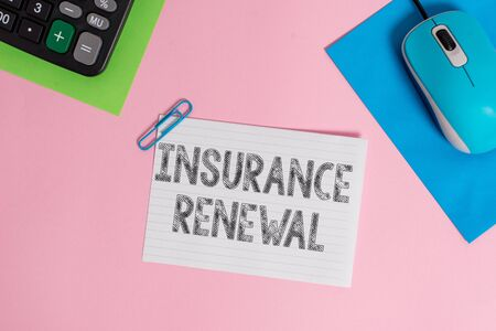 Conceptual hand writing showing Insurance Renewal. Concept meaning Protection from financial loss Continue the agreement Wire electronic mouse calculator paper colored background