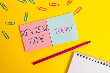 Handwriting text Review Time. Conceptual photo to think or talk about something again Set schedule to review Colored square blank sticky spiral notepads pencil clips color background