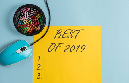 Conceptual hand writing showing Best Of 2019. Concept meaning great and marvelous things and events happened on 2019 Notebook and stationary with gadgets above pastel backdrop Stok Fotoğraf