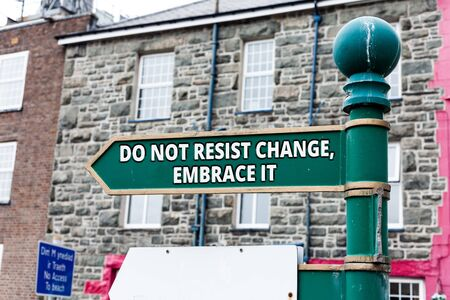 Writing note showing Do Not Resist Change Embrace It. Business concept for Be open to changes try new things Positive