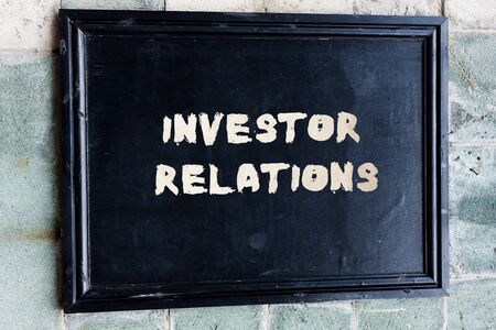 Writing note showing Investor Relations. Business concept for analysisagement responsibility that integrates finance