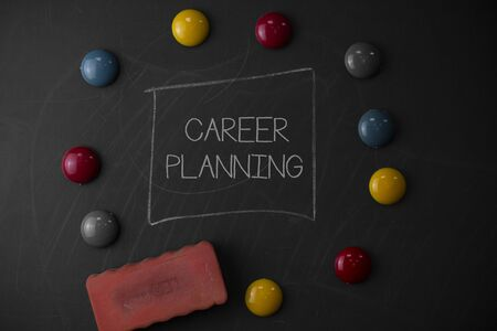 Text sign showing Career Planning. Business photo text A list of goals and the actions you can take to achieve them Round Flat shape stones with one eraser stick to old chalk black board Stok Fotoğraf