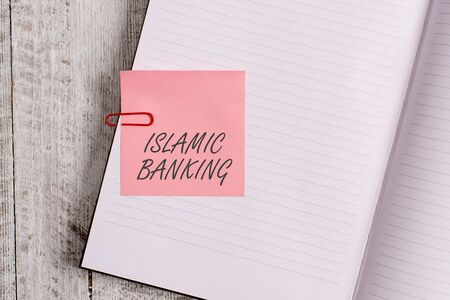 Writing note showing Islamic Banking. Business concept for Banking system based on the principles of Islamic law Notebook stationary placed above classic wooden backdrop Stok Fotoğraf